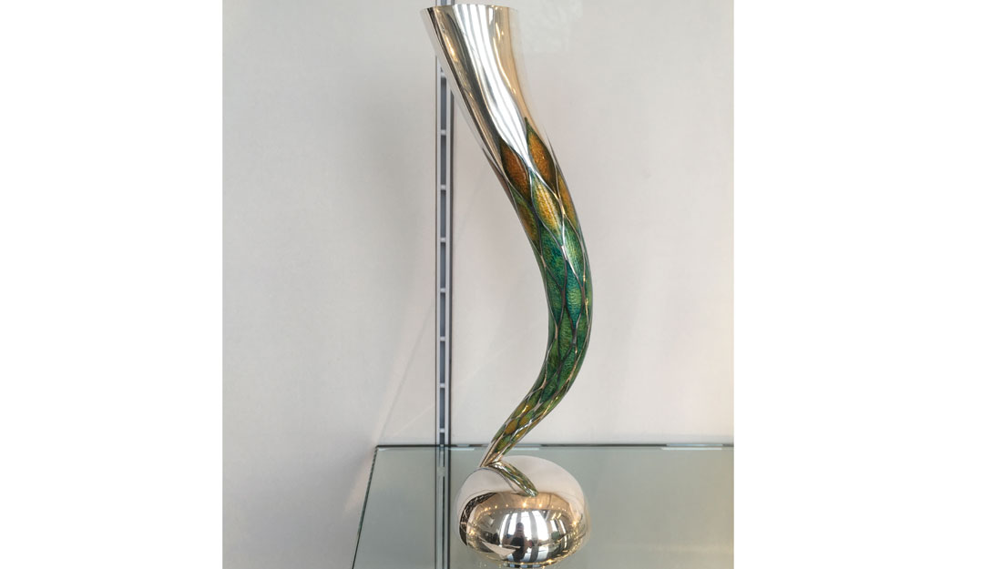green & silver vase in the shape of a horn