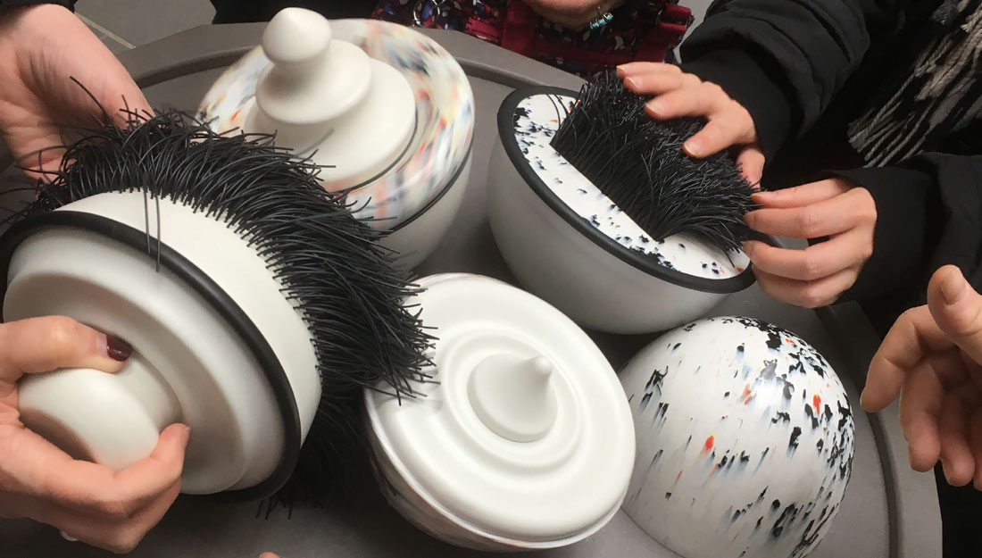 white bowls with black and red points, some look soft, but they're firm to touch.