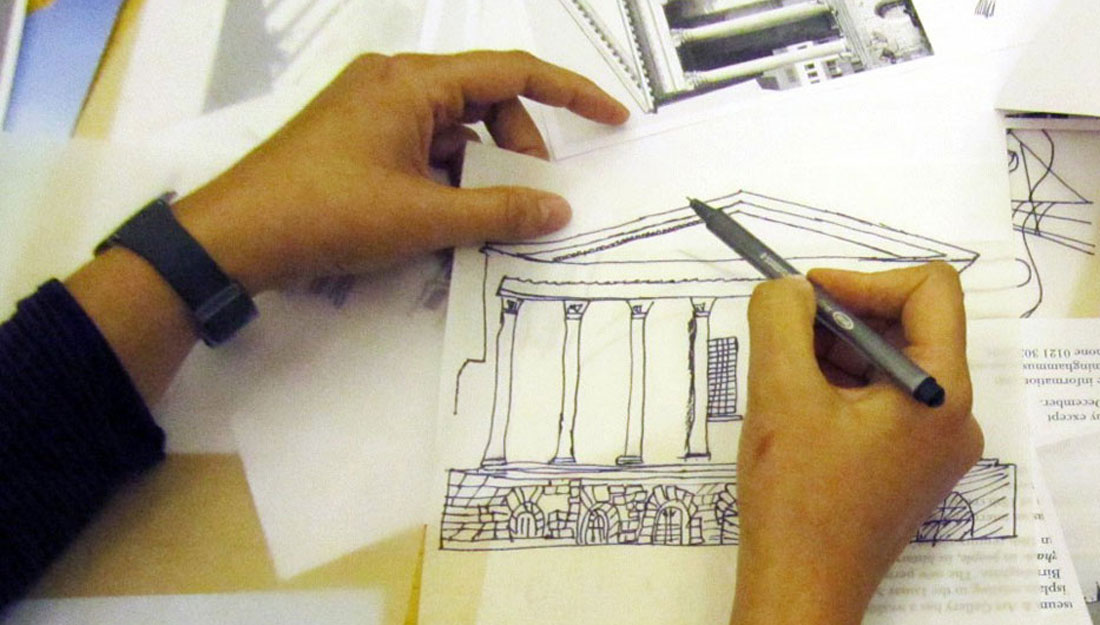 A woman is drawing a building freehand