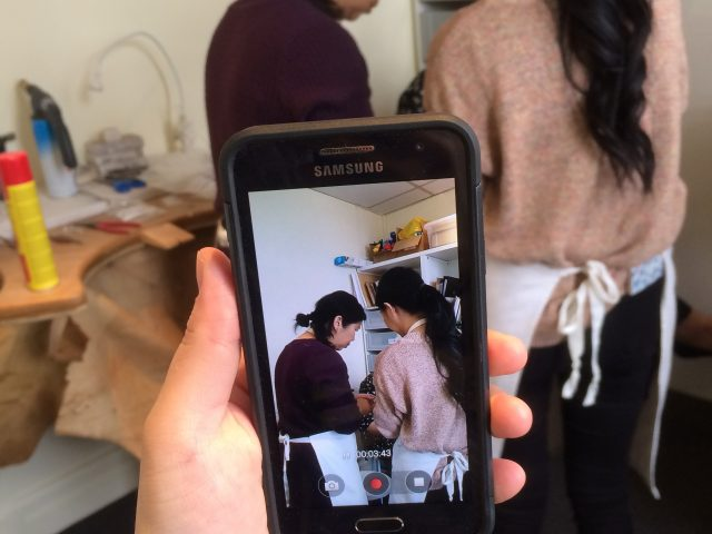 Taking a video of the two women at work