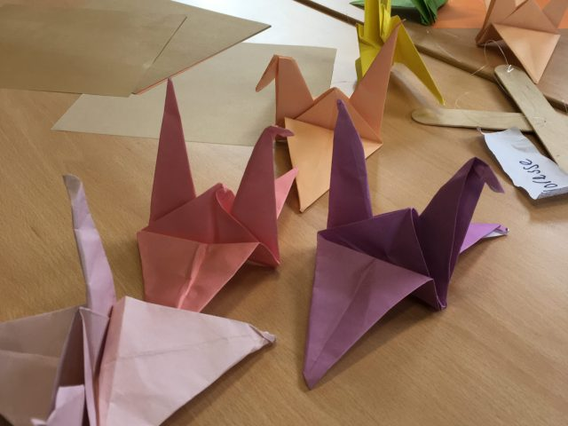 These four Origami cranes have to be attached to the wooden sticks.