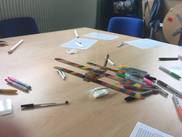 the rainbow plane is attached to a string