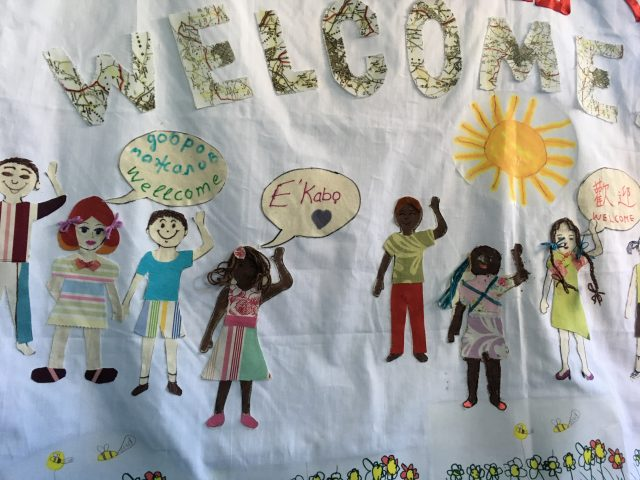 the welcome banner with the illustration of the ASIRT kids