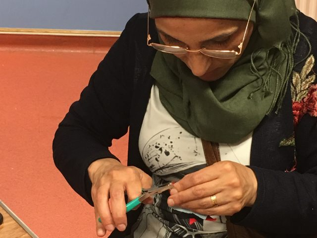 Refugee Action client making key ring