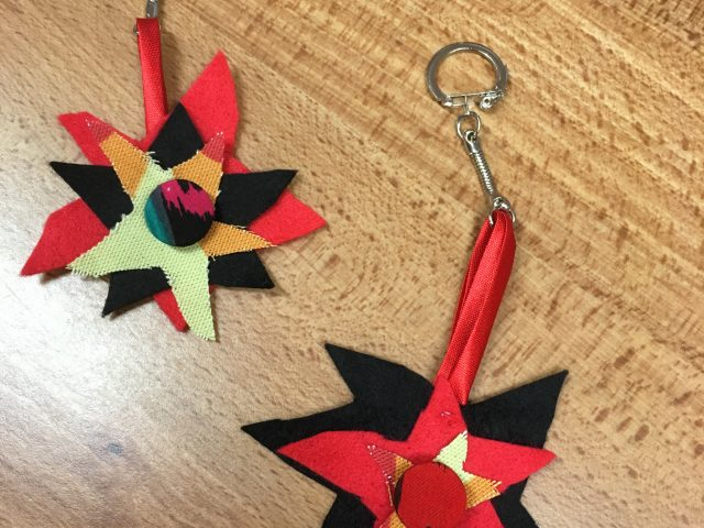 Fabric keyrings made by Refugee Action clients in workshop