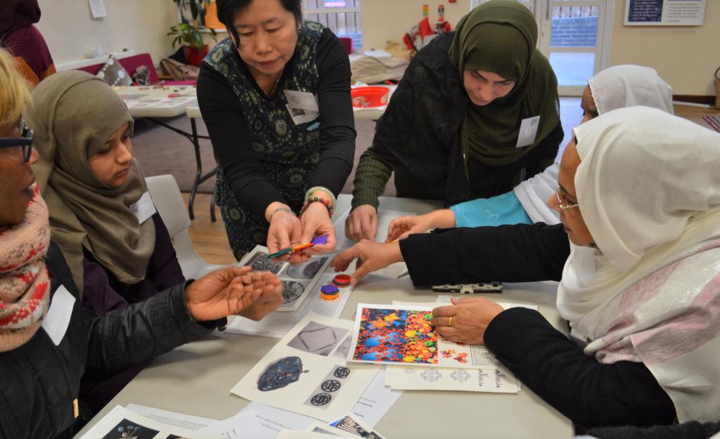 shelanu showing women how to make the brooches