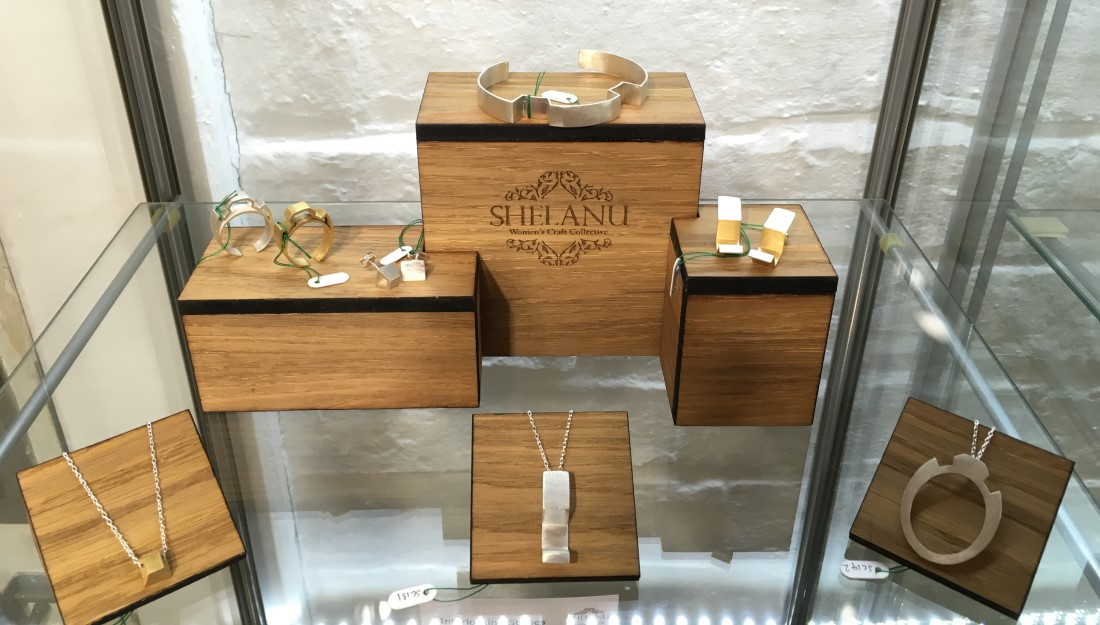 silver jewellery collection 'interlocking stories' displayed on wooden stands