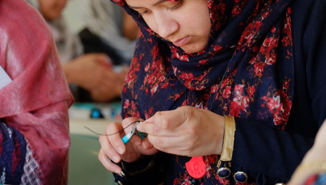 participant making necklace