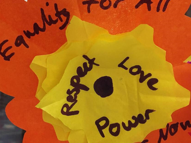 paper flower art with words 'equality for all' 'respect, love, power'