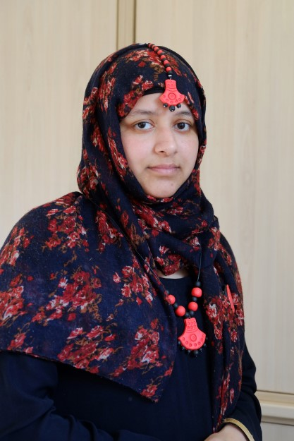 participant wearing her hand made tikka and necklace